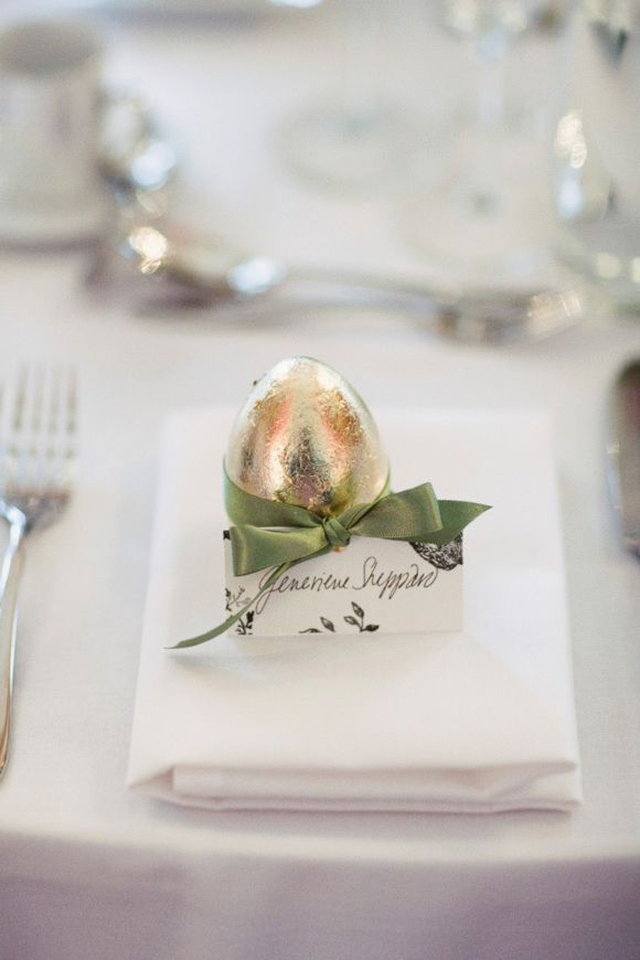 Gold egg escort card... The goose that laid the golden egg! hang on to those cheap plastic easter eggs spray and fill with candy!!!