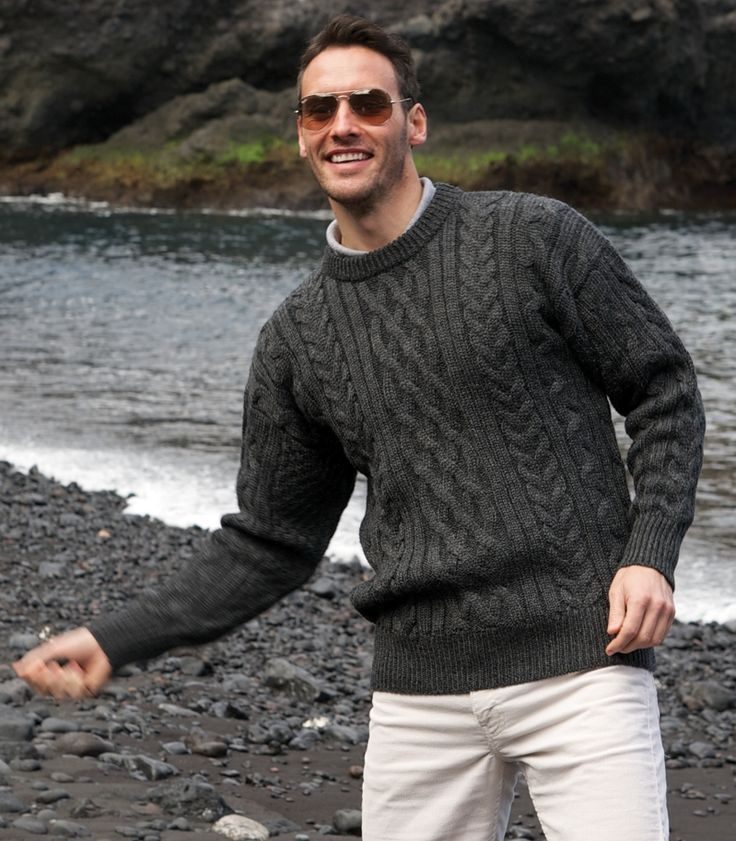 Remaining faithful to the origins of Aran, our range of Aran sweaters for men includes crew neck jumpers, zip and button cardigans, jumpers with hoods and stylish waistcoats, which come in a range of colors such as classic cream and stylish charcoal grey and navy blue and much more. Clear Filters. Sweaters for Men.