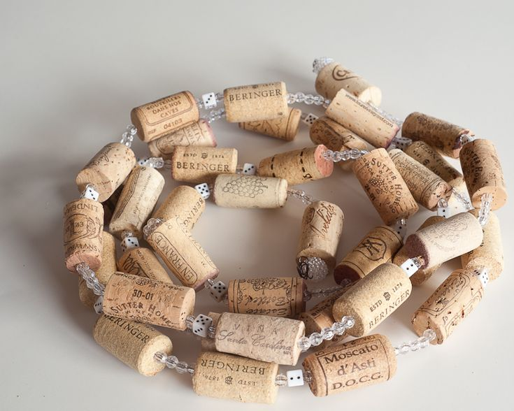 WINE-CG-VD (8.5)  Wine cork garland, wine cork decorations, wine party decorations, casino  party and las Vegas party decorations your home. Bunco decor !    I am a huge wine lover, and you may be also...so why not a wine themed  garland ? This fun garland will give your tree a rustic feeling, also drape  over mantles or stair case rails? This is great for your poker party.   Garland is 8 feet long. Made from used wine corks, white dice, and white  crystals wired together.