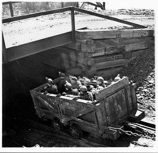 Coal Miners Descending into Mine in Oar Car