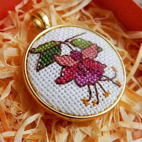 """The #pendant """"Fuchsia"""" is handmade item with #miniature #crossstitch (size of one microstitch is less than 1mm). Size of pendant 29x29mm, colour of the frame is gold. The pend... #necklace #fuchsia #flower #pink #microstitch' #birthday"""