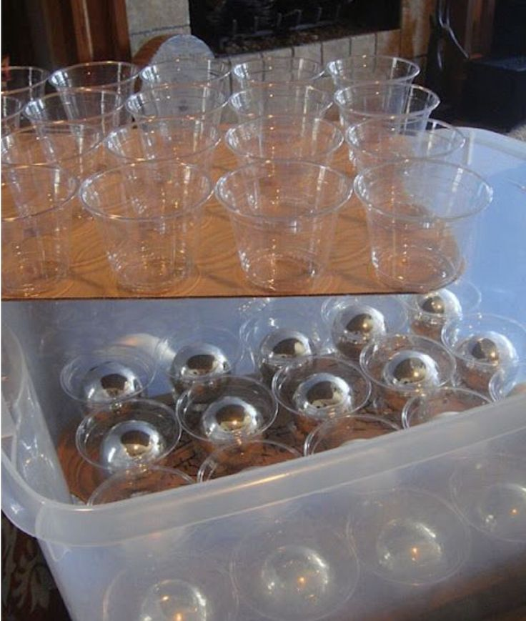 DIY Christmas ornament storage. Glue plastic cups to cardboard to store ornaments in a large storage container.