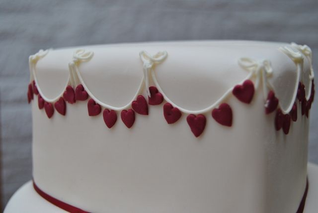 The top tier decorated with heart bunting.