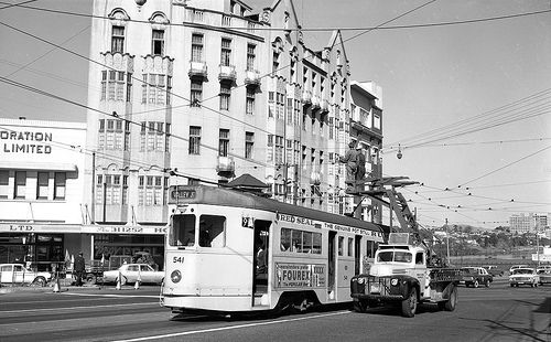 FM541 and an overhead line checker pass at the intersection of Queen and Adelaide Streets, Petrie Bight and The Atcherley Hotel, now demolished and replaced by the Marriott Hotel.