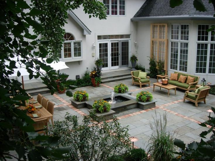 This Beautiful Patio Features A Central Fountain Surrounded By Bluestone  Pavers. Brick Bands Help Define