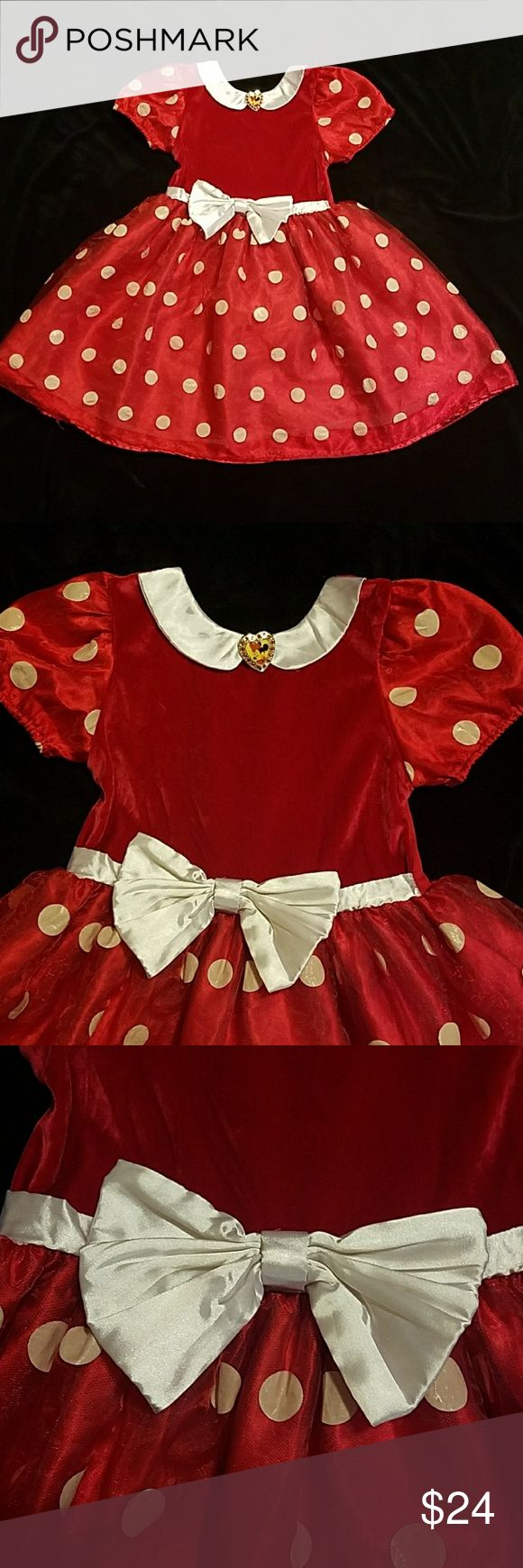 Minnie Mouse dress size 7/8 Red velvet bodice with satin sleeves and a satin underskirt with a tulle polka dot overlay.  Perfect for that Disney vacation this year!   There is a slight hole on the underlayer  of the skirt as shown in the last picture but it cannot be seen while worn. Disney Costumes