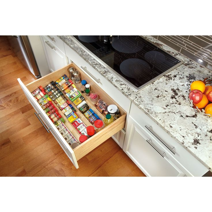 Keep spices conveniently stored in a drawer by the stove with Rev-A-Shelf's wood spice drawer insert.