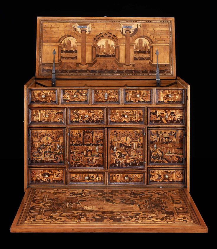Table Cabinet. German (Augsburg) about 1580 - 1600. Wood; oak and pine veneered with maple, cherry, beech, and other woods, gilt brass, iron. 57 x 92.5 x 41 cm. All surfaces of the chest including the interior drawers and doors are decorated with a combination of marquetry and intarsia composed of a variety of European woods. The distinctive material used on this cabinet is the green mottled colored veneer which resembles marble. -MUSEUM OF FINE ARTS, BOSTON-