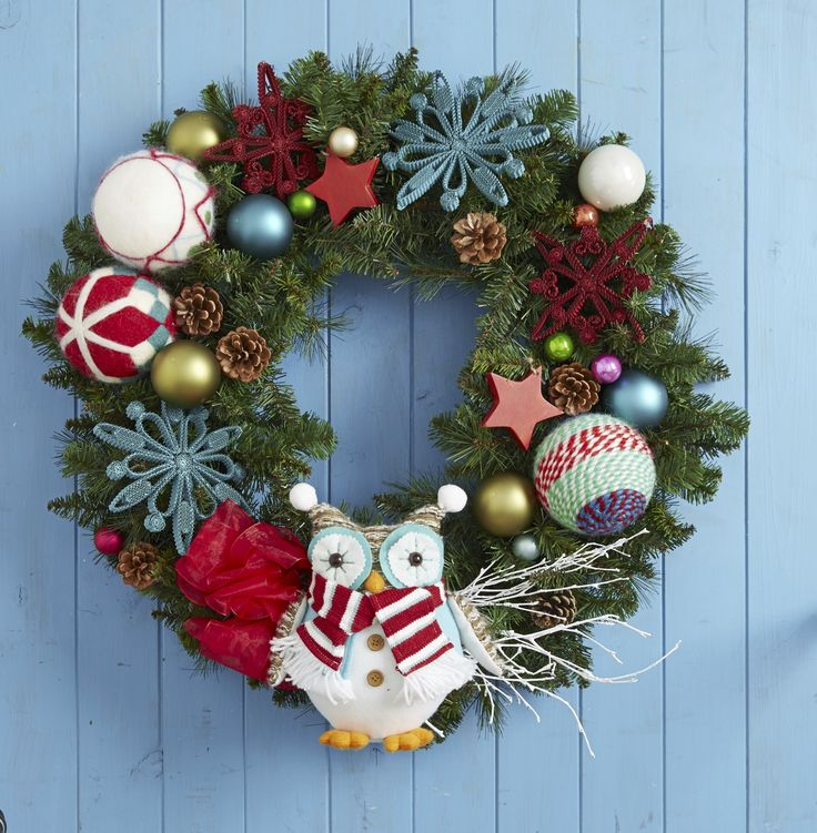 For a little Christmas whimsy, decorate a real or artificial holiday wreath with colorful, fun ornaments in a variety of shapes and materials.