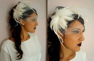 Headpiece with feathers and veil.
