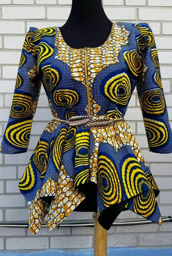 African print blouse u-neck and zipper in front ,peplum top to wear with skirt or pant Blouse is ready to ship Fully linned Belt not included Available in all sizes 0_18 us Xsmall_1x standard us size Fabric care; Dry clean Always iron at the back please for perfect fit check our size chart, you can drop your measurement if your size is different from the chart.