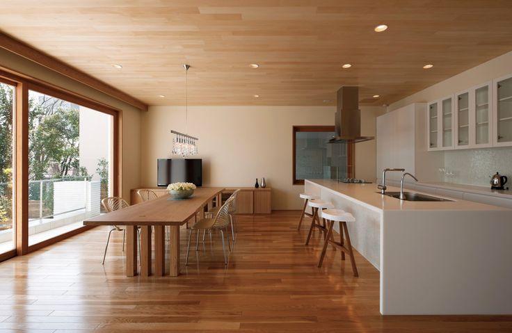 Open concept. White kitchen. Light wood. MUJI VIBE.