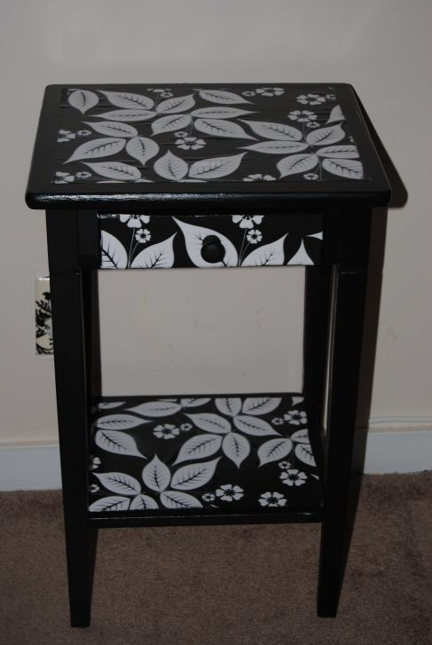 Upcycled table restyled with Decoupage and made with Mod Podge and scrapbook paper.
