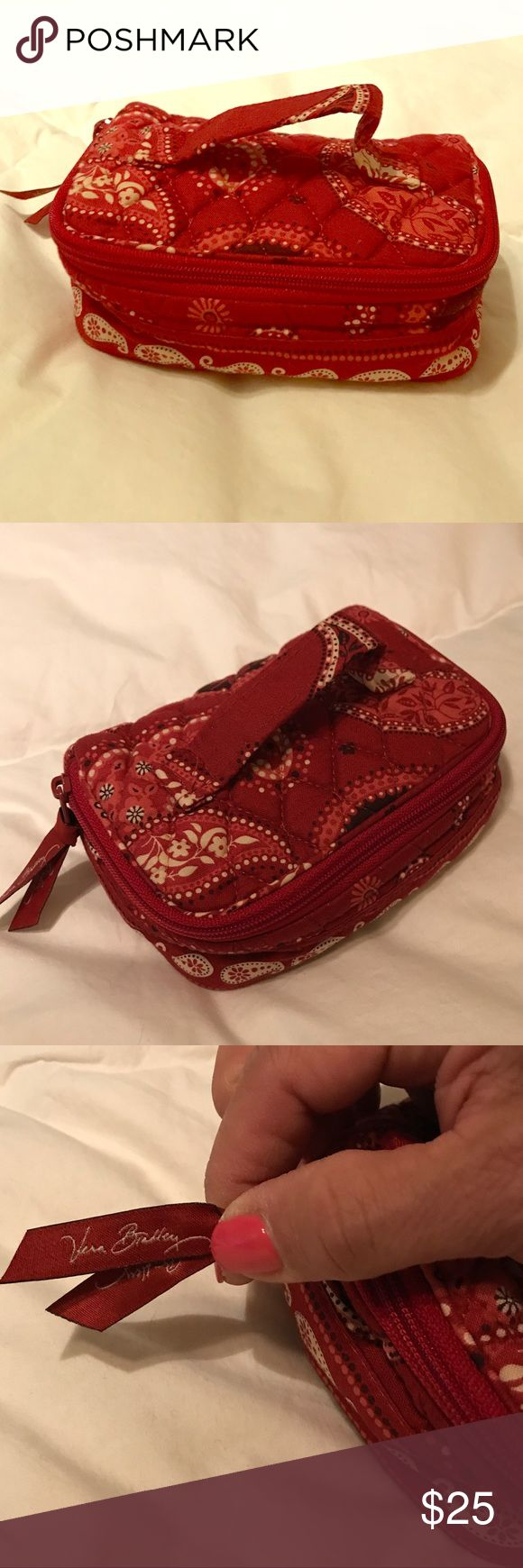 Vera Bradley Travel Jewelry Box Vera Bradley Travel Jewelry Box in beautiful, red Vera Bradley pattern. This is an older pattern that is very hard to find. EUC with zippers and different compartments to keep your jewelry separate. Vera Bradley Bags Travel Bags