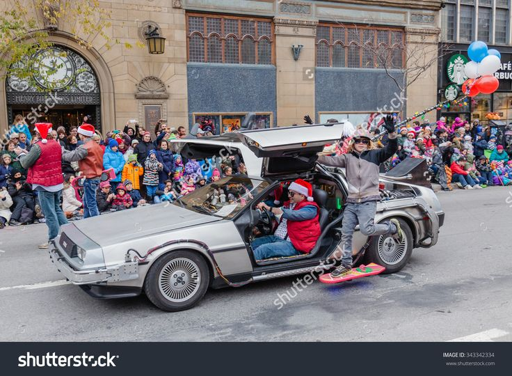 Montreal, Quebec, Canada - November 21, 2015 : Marty Mcfly With Delorean In The 65th Edition Of The Santa Claus Parade Destination Centre-Ville (Defile Du Pere Noel) Along Saint Catherine Street. Стоковые фотографии 343342334 : Shutterstock