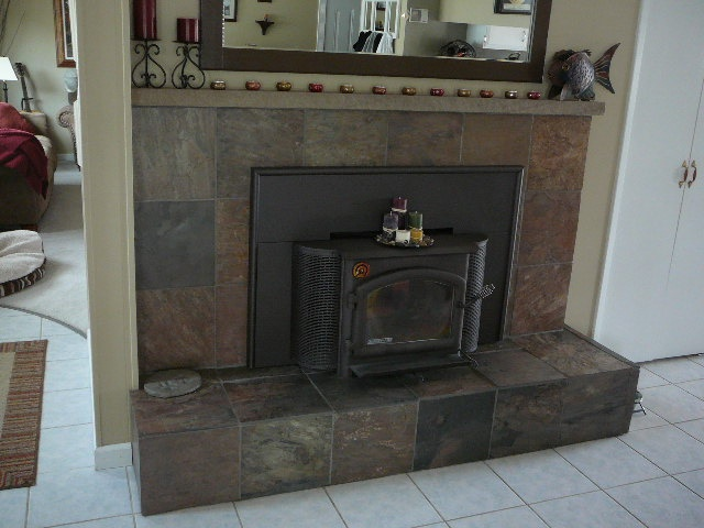 Slate tiled over red brick fireplace with boxed down - Tile over brick fireplace ...