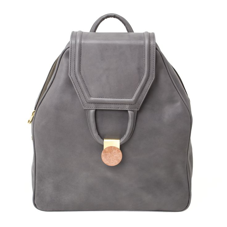 CAMPI   A bag of a level as high as the peak that inspired it,  which, from its 2,200 meters  gives truly precious views.   In the handmade pink stone rosette  dominates the bronze clip, individuating this backpack. Women's smooth Tuscan hand-colored, vegetable-tanned leather bag/backpack. http://www.vodivi.com/shop/en/home/15-campi.html