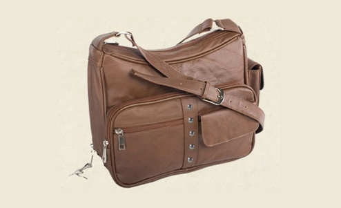 Our top selling GUN purse for January 2013.  Available in black, brown, red, tan, cream, navy and olive green.    http://creativeconcealment.biz/Organizer-Holstered-Shoulder-Purse-RO-7081.htm  Only $62.00.  Want one???