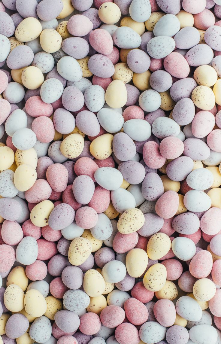 An overhead shot of dozens of candy chocolate mini Easter eggs