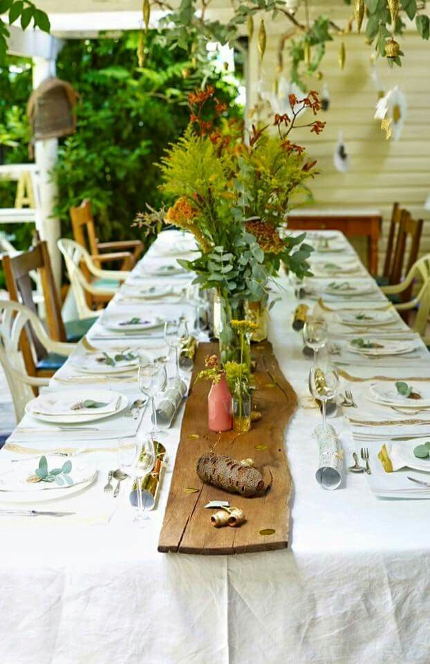 Our family bush christmas 2015. Had fun deecorating this years theme with Aussie native bush and a bit of gold sparkle.  Suspended branch with blue ecculuptus leaves and copper fiary lights, dipped gold glitter gum nuts, white feathers with ends dipped in gold glitter and gold glitter decorations. Found some fabulous jarrah face cuts as our table runner - decorated with bottles (some dipped is gold glitter) and vases of Aussie natives and scattered gold glitter gumnuts.  Christmas table…
