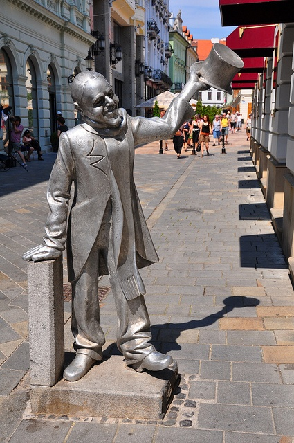"Statue of Schoener Naci (Beautiful Ignaz) - Bratislava, Slovakia;  he was a well-dressed man in the early 20th Century who tried to bring happiness to the streets of the city (for example, greeting women with the words, ""I kiss your hand"" in 3 languages);  he received free food from several of the city's cafes, and supported himself with occasional cleaning work;  photo by WashuOtaku (Mark Clifton), via Flickr;  info from Wikipedia"