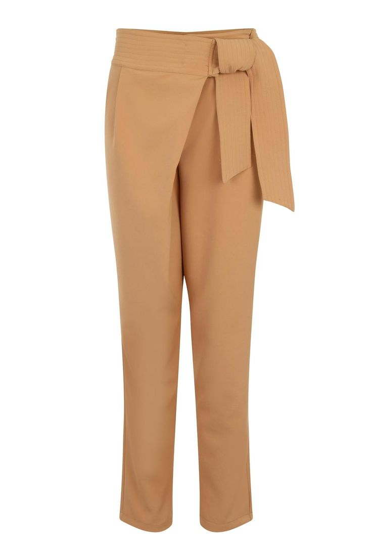 Effortlessly smart, these camel trousers feature a cool crossover fold front and a stitched sash tie belt. Perfect for work, evenings and weekends, they can be dressed up or down. Made from premium woven non-stretch fabric, the trousers have side pockets and an invisible zip to the front. Hand wash only.   Tie Belt Trouser by LAVISH ALICE. Clothing - Bottoms - Pants & Leggings Illinois