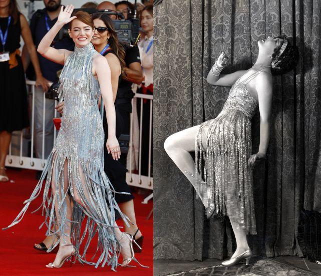 """Emma Stone Vs. Dorothy Sebastian  En la pasada edición del Festival de cine de Venecia, Emma Stone deslumbró con un vestido """"glitter"""" de Atelier Versace. El diseño, escogido por su estilista Petra Flannery, destacaba por una falda larga con flecos de cuentas plateadas, emulando el estilo de las """"flappers"""" de los años 20.  Una falda de tiras similar a la que lució la actriz Dorothy Sebastian en la película muda """"Sackcloth and Scarlet"""" (1925)."""