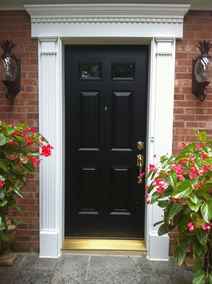 Lovely Black Wooden Exterior Front Door Ideas With White Trim As Well As  Red Bricked Walls