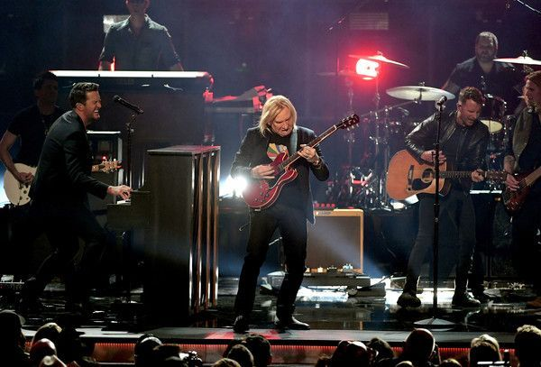 Luke Bryan Photos Photos - (L-R) Co-host Luke Bryan, recording artist Joe Walsh, and co-host Dierks Bentley perform onstage during the 52nd Academy Of Country Music Awards at T-Mobile Arena on April 2, 2017 in Las Vegas, Nevada. - 52nd Academy of Country Music Awards - Show