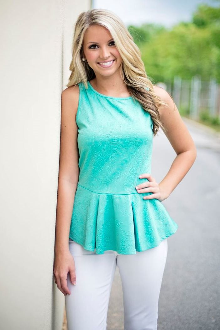 """You will be all smiles in this paisley embossed peplum top! It is mint colored, featuring a key hole back button closure. Kelli is 5'5"""" and is modeling a small. Made in U.S.A. 92% Polyester 8% Spandex"""