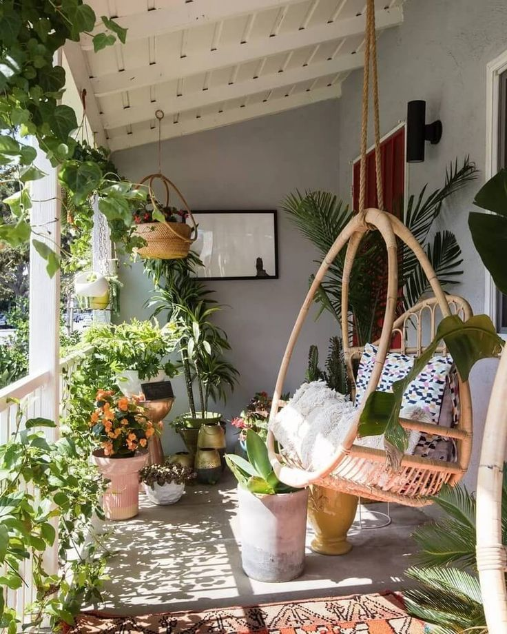 Hanging plants make this terrace incredible boho. …