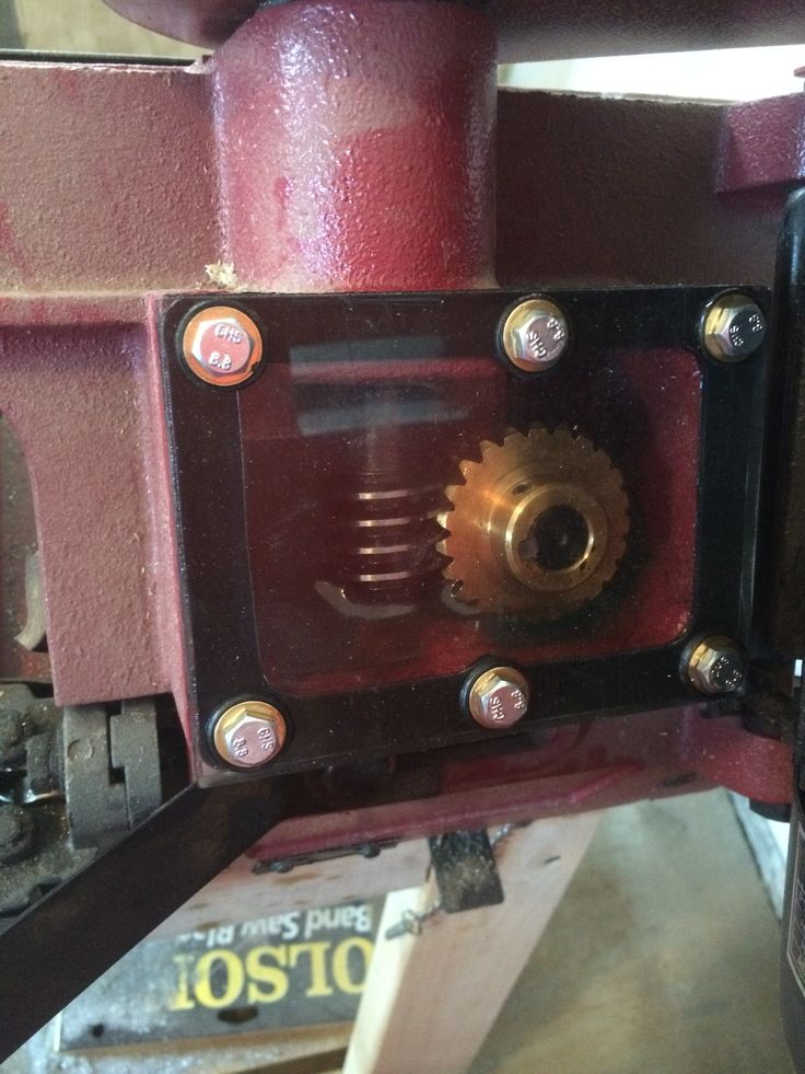 Polycarbonate gearbox cover for a horizontal band saw.