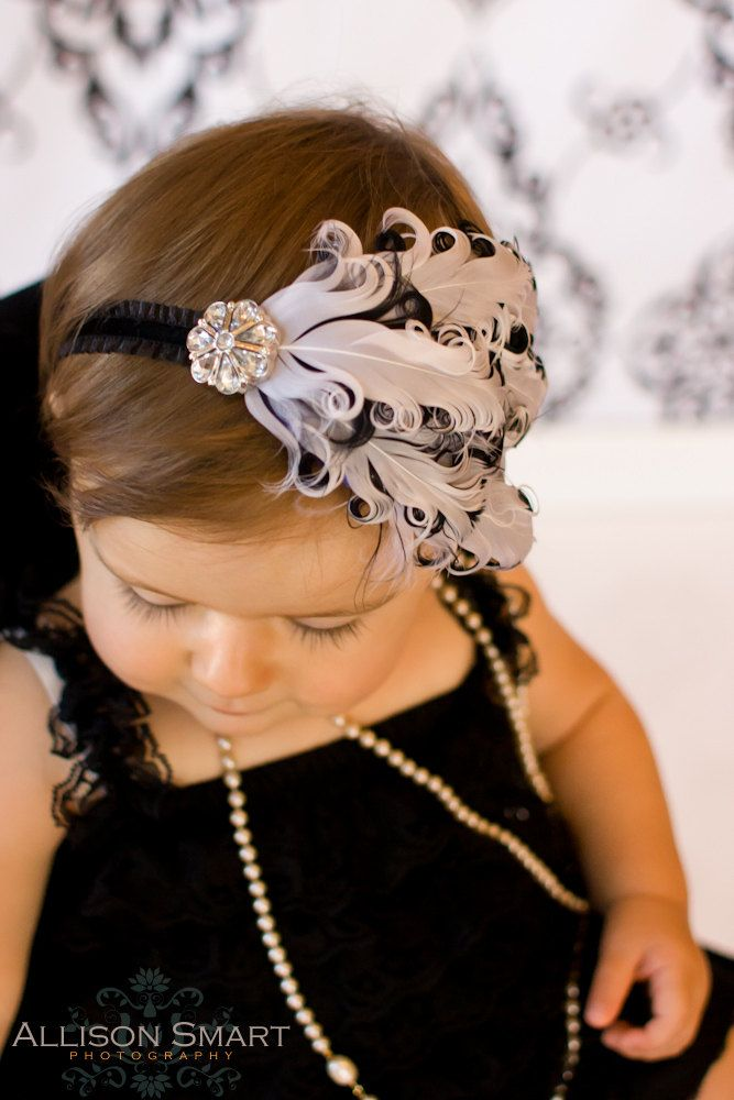 baby headband girls feather white with black edges bling rhinestone on ruffled elastic all sizes. $14.00, via Etsy.