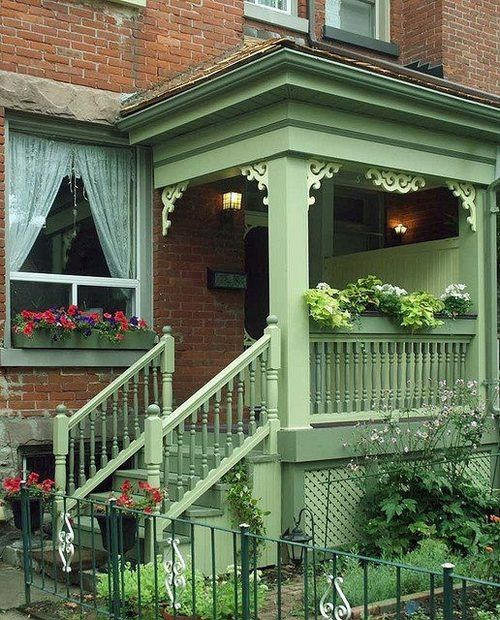 Porch...a little bit cottage...love the green with gingerbread trim./