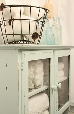 Distressed Green Blue Freestanding Cabinet With Glass Doors Used For Linens Wire Egg Basket
