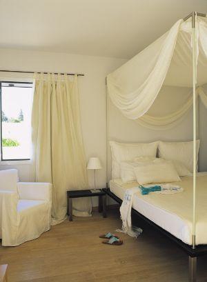 Master bedroom of Presidential Suite at Minos Beach art