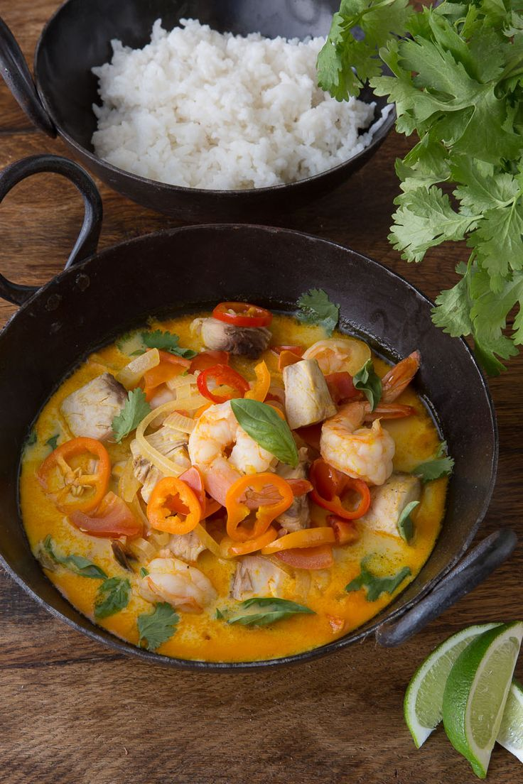 Moqueca is a Brazilian fish stew made with various kinds of seafood, coconut milk, tomatoes, onions, garlic, fresh cilantro and palm oil.