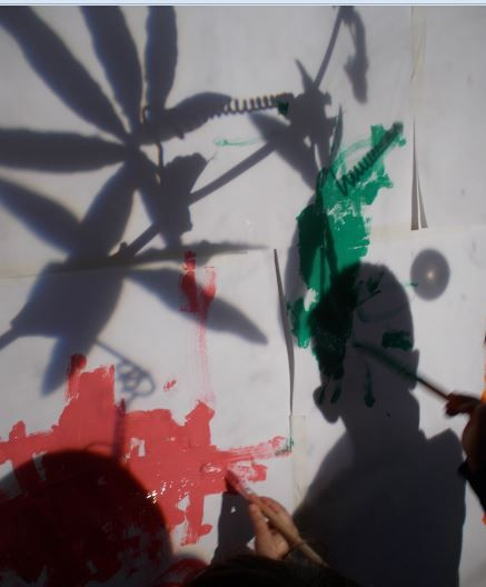 Painting shadow's from an over head projector at Chadwell Pre School.