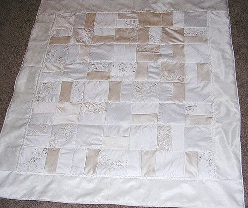 This was a custom quilt made from a wedding dress.  What a great way to turn a dress you wear one day into a beautiful decor item that you can display and use for years and years!