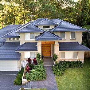 Project: North Rocks Home. Boral Concrete Roof Tile - Contour concrete roof tiles in Gunmetal.   Lanscaped with lush green surrounds, the Boral Contour roof tiles in Gunmetal produce a vivid contemporary contrast for this modern home.  The roof design fea