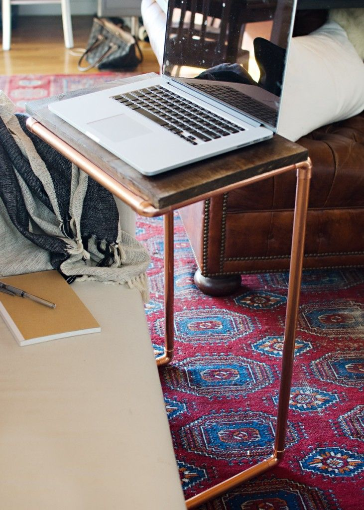Because who doesn't need a copper pipe laptop stand? Bye Bye desk, Hello comfy seat! #DIY
