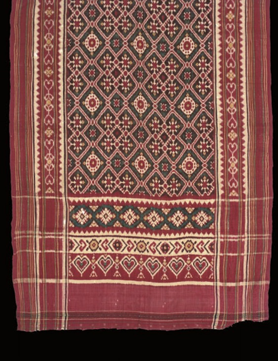 Double ikat patola, Gujarat India for the Indonesian market, late 18th century   woven with geometric lattice and pallu of heart-shaped cartouches--32.5in. x 97in. (83cm. x 246cm.) along with Sumatran patola of red silk woven with gilt, 20th Century.