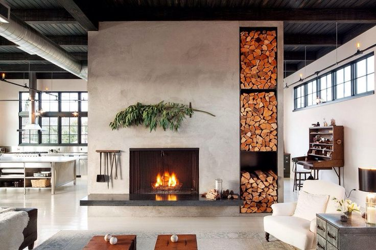 Huge fire wall chimney breast with log store in contemporary US interior