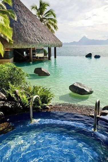 The Four Seasons in Bora Bora might cost a pretty penny, but those picturesque luxury huts floating above the water make it seem totally worth it.