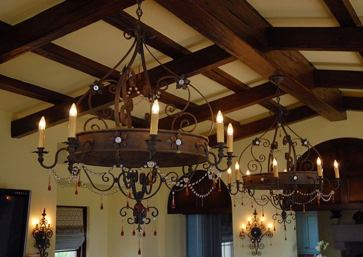Interior Ceiling Designed With Wooden Beams And Illuminated With Hanging Wrought Iron Chandeliers Majestic Wrought Iron Chandeliers Create Rustic Feel Check more at http://www.wearefound.com/majestic-wrought-iron-chandelier-create-rustic-feel/