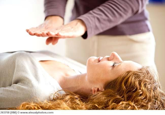 First Degree Reiki Training at Providence Zen Center - Providence Life Coaching Reiki Counseling - Woman receiving reiki treatment.