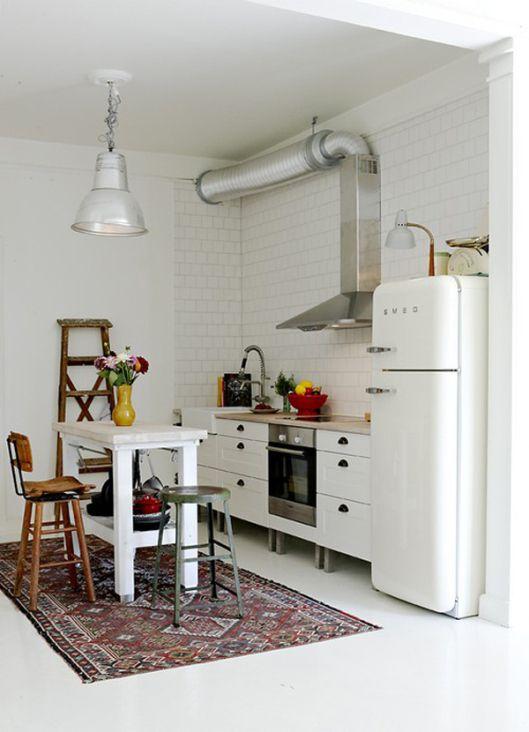 kilim rug and SMEG in white Scandinavian kitchen