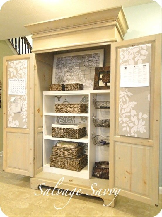 This is a beautiful re-done armoire made into a wonderful organizational tool!  I could use this in the foyer as a pretty piece of furniture but a place to hide my craft stuff.