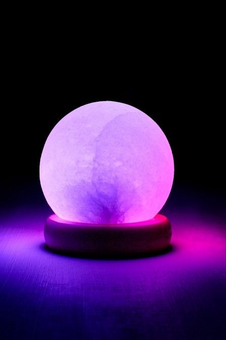 """<p>This Round Mini USB Salt Stone Lamp with changing colors is hand carved from salt excavated from the Himalayan Mountains. When the salt is heated, it releases negative ions, also known as """"Vitamins of the Air"""". The negative ions are said to calm nerves, revitalize cells and purify the air for a holistic experience.</p> <p><em>Due to the unique nature of Himalayan salt, no two lamps are exactly alike in shape, size or color.<br /></e..."""