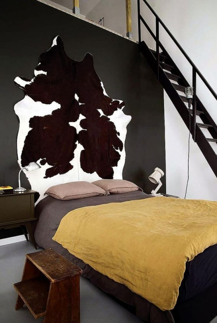 Elegant Black and White Gold Interior Bedroom Design with CowHide Wall Decor
